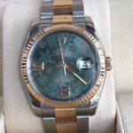 Rolex 116203 mặt xanh đá hoa đào sản xuất năm 2005