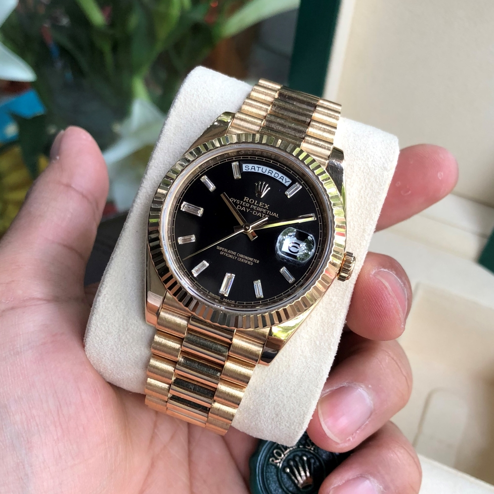 Rolex Day-Date 228238 Black Dial Diamond Baguette Yellow Gold