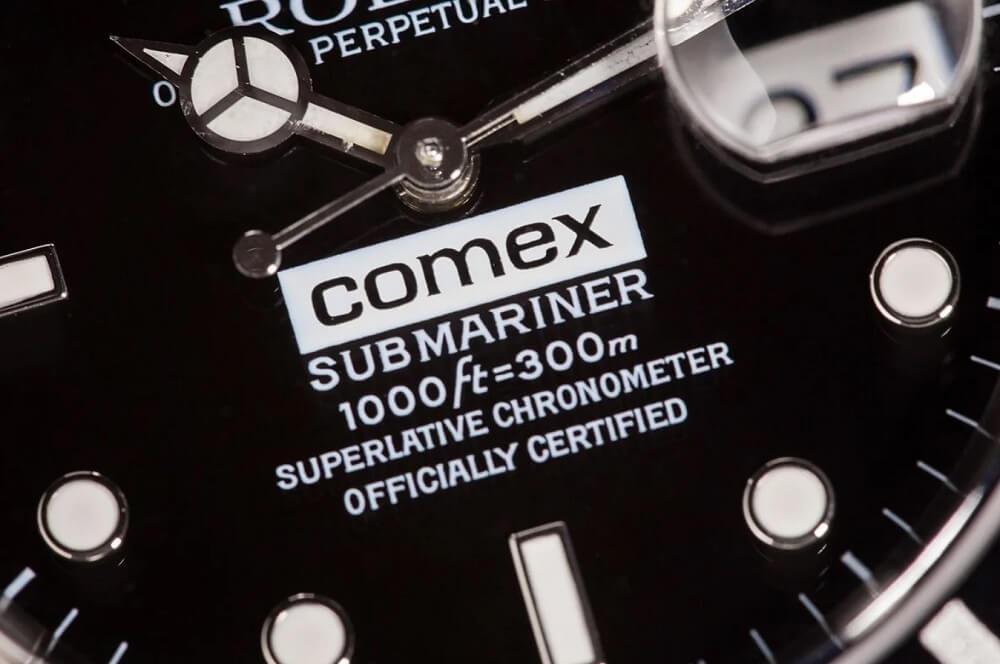 Biểu tượng COMEX trên mặt số đồng hồ Rolex Submariner 16610